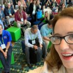 Jodi selfieing with the crowd at her session at The Car Wash Show.